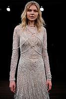 Maja Brodin walks the runway wearing Naeem Khan Bridal Spring 2018