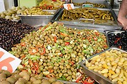 display of different olive on market
