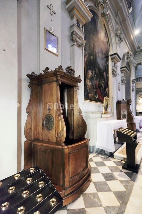 ornate confessional near an altar Italy