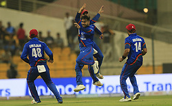 September 17, 2018 - Abu Dhabi, United Arab Emirates - Afghanistan cricketers Rashid Khan and his team mates celebrates after taking a wicket during the 3rd cricket match of Asia Cup 2018 between Sri Lanka and Afghanistan at the Sheikh Zayed Stadium,Abu Dhabi, United Arab Emirates. 09-17-2018. (Credit Image: © Tharaka Basnayaka/NurPhoto/ZUMA Press)