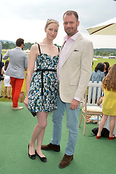 JADE PARFITT and JACK DYSON at the St.Regis International Polo Cup at Cowdray Park, Midhurst, West Sussex on 17th May 2014.