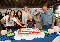 Jennifer Anderson, Cynthia Makris, Governor Chris Sununu, Hope Makris, Karen Makris and Charlie St Clair celebrate with the crowd during the 96th cake cutting at the Naswa Beach Bar on Wednesday evening.  (Karen Bobotas/for the Laconia Daily Sun)