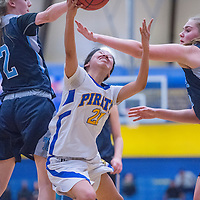 Valley Sanders Pirate Valiyah Yazzie (21) shoots under a block attempt from the Gregory School Hawks Saturday at Prescott High School.