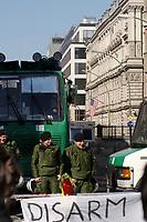 """22 MAR 2003, BERLIN/GERMANY:<br /> Polizei mit Wasserwerfer schuetzt die Botschaft der USA, waehrend einer Anti-Kriegs-Demonstration gegen den Irak-Krieg, an einer Absprerrung haengt ein Transparent """"Disarm the USA"""", Unter den Linden<br /> Police is protecting the US Ebassy during an anti-war demonstration against the iraq war, a banner """"disarm the USA"""" is hanging at a barrier, Unter den Linden<br /> IMAGE: 20030322-01-007<br /> KEYWORDS: peace-demonstration"""