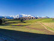 MacKenzie Country's pastures with the Four Peaks Range in the background, New Zealand.
