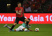 Victor Lindelof tackles Stefano Sensi during an International Champions Cup game won by Manchester United 1-0, Saturday, July 20, 2019, in Singapore. (Kim Teo/Image of Sport)
