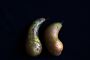 two Pears on black background