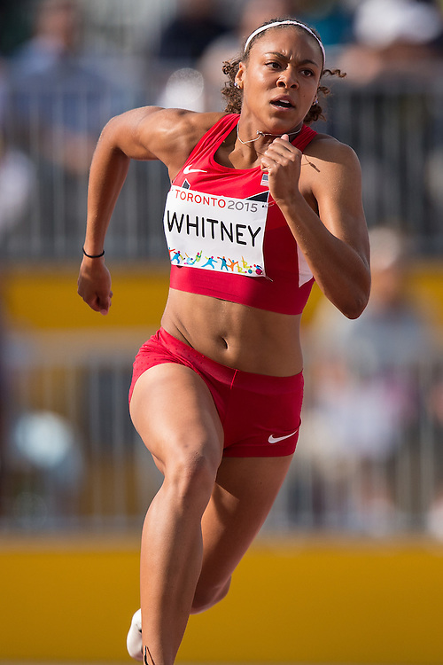 Kaylin Whitney of the United States competes in the women's 200 metre final at the 2015 Pan American Games at CIBC Athletics Stadium in Toronto, Canada, July 24,  2015.  AFP PHOTO/GEOFF ROBINS