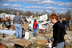 24 February 2016. Sugar Hill RV Park, Convent, Louisiana.<br /> Scenes of devastation following a deadly EF2 tornado touchdown. 2 confirmed dead. <br /> Rylan Johnson (7 yrs) helps recover family belongings from the flipped trailers and cars dotting the landscape.<br /> Photo©; Charlie Varley/varleypix.com
