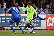 AFC Wimbledon midfielder Jake Reeves (8) tackling Peterborough United midfielder Callum Chettle (23) during the EFL Sky Bet League 1 match between AFC Wimbledon and Peterborough United at the Cherry Red Records Stadium, Kingston, England on 17 April 2017. Photo by Matthew Redman.