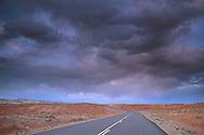 Evening storm clouds over empty desert road near Goblin Valley, Utah   Stormy sunset over high desert road near Goblin Valley State Park, San Rafael Swell region, UTAH