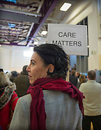"Westbury, New York, USA. January 15, 2017.  A woman holds a ""CARE MATTERS"" sign on a woman stick at the ""Our First Stand"" Rally against Republicans repealing the Affordable Care Act, ACA, taking millions of people off health insurance, making massive cuts to Medicaid, and defunding Planned Parenthood. Hosts were Reps. K. Rice (Democrat - 4th Congressional District) and T. Suozzi (Dem. - 3rd Congress. Dist.). It was one of dozens of nationwide Bernie Sanders' rallies for health care that Sunday."