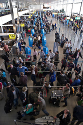 Passengers stranded by the ash cloud from a volcanic eruption in Iceland, line up to rebook flights at Schiphol Airport in Amsterdam, the Netherlands, on Tuesday, April 20, 2010. (Photo © Jock Fistick)