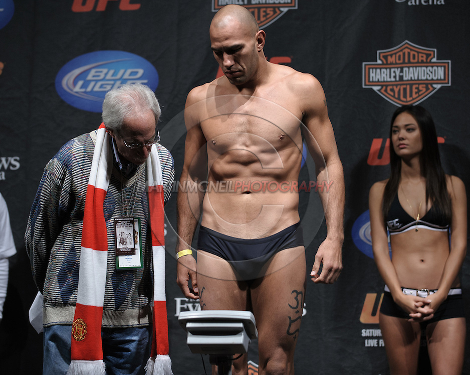 MANCHESTER, ENGLAND, NOVEMBER 13, 2009: Brandon Vera (center) steps on the scales during the weigh-ins for UFC 105 at the MEN Arena in Manchester, England on November 13, 2009.