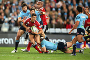 Dan Carter tackled. NSW Waratahs v Canterbury Crusaders. Sport Rugby Union Super Rugby Representative Provincial. ANZ Stadium. 23 May 2015. Photo by Paul Seiser/SPA Images