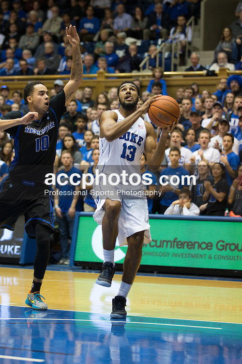 DURHAM, NC - DECEMBER 05: Matt Jones #13 of the Duke Blue Devils drives to the basket under pressure from Jarryn Skeete #10 of the Buffalo Bulls during a 59-82 Duke Blue Devils win on December 05, 2015 at Cameron Indoor Stadium in Durham, North Carolina. (Photo by Peyton Williams/Getty Images) *** Local Caption *** Matt Jones;Jarryn Skeete
