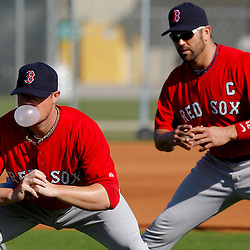 February 23, 2011; Fort Myers, FL, USA; Boston Red Sox starting pitcher Jon Lester (front) and catcher Jason Varitek (rear) stretch during spring training at the Player Development Complex.  Mandatory Credit: Derick E. Hingle