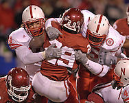 University of Oklahoma running back Chris Brown (29) gets stuffed at the line by the Nebraska defense, during the Big 12 Championship game at Arrowhead Stadium in Kansas City, Missouri, December 2, 2006.  Oklahoma beat Nebraska 21-7.<br />