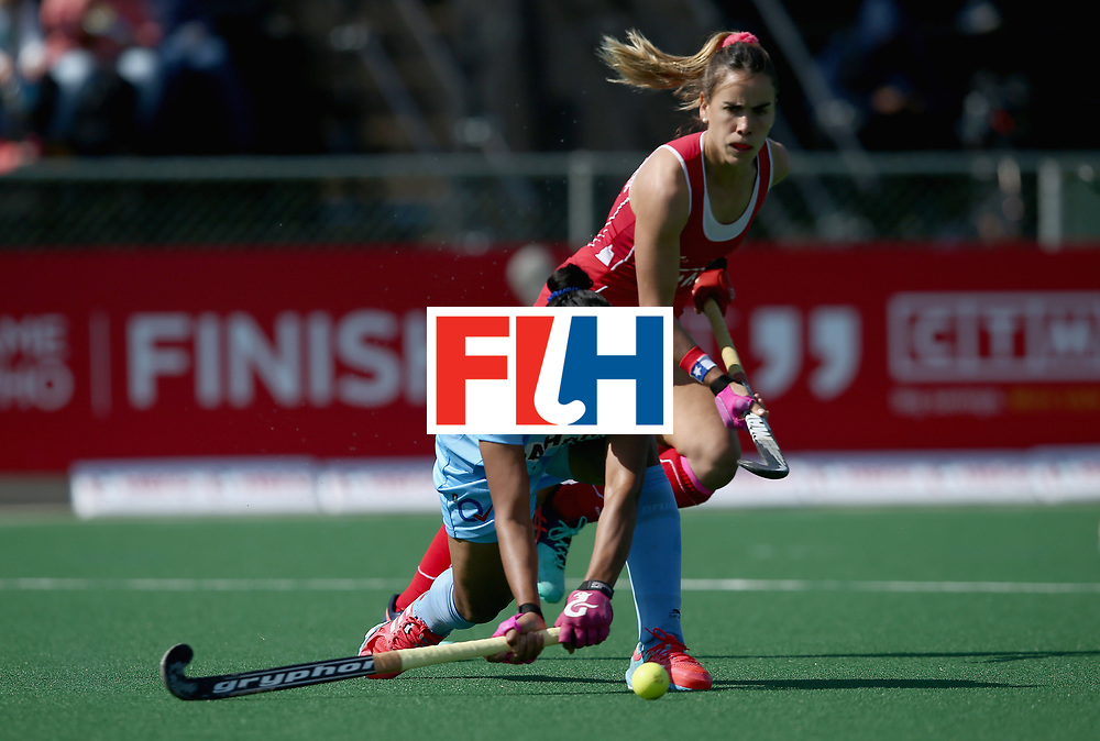 JOHANNESBURG, SOUTH AFRICA - JULY 12: Deep Ekka of India and Josefa Villalabeitia of Chile battle for possession during day 3 of the FIH Hockey World League Semi Finals Pool B match between India and Chile at Wits University on July 12, 2017 in Johannesburg, South Africa. (Photo by Jan Kruger/Getty Images for FIH)