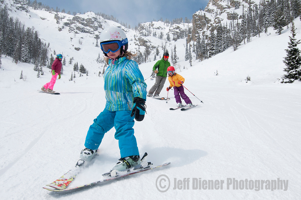 A family skis at Jackson Hole Mountain Resort, Jackson Hole, Wyoming.