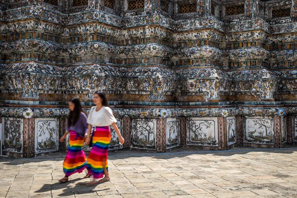 BANGKOK, THAILAND - CIRCA SEPTEMBER 2014: Thai women walking in Wat Arun, a  popular Buddhist temple in Bangkok Yai district of Bangkok, Thailand, on the Thonburi west bank of the Chao Phraya River