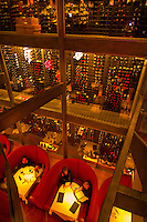 Dining at the Cypress Restaurant on East Bay Street (with a three story wine rack in the background), Charleston, South Carolina