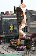 "JINAN, CHINA - AUGUST 05: <br /> <br /> The giant naked fat sculpture is tore down from the roof on August 5, 2016 in Jinan, Shandong Province of China. Two giant naked men sculptures named ""Happy Fat\"" were tore down from the building roofs again as they didn\'t confirm with some design specifications in Jinan. ©Exclusivepix Media"