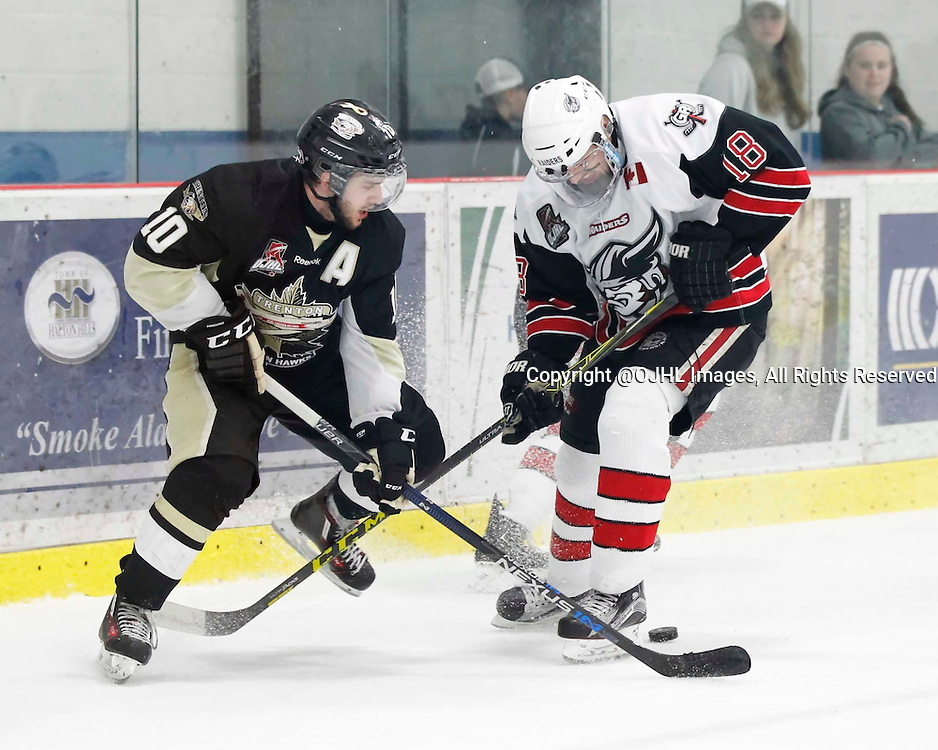 GEORGETOWN, - Apr 15, 2016 -  Ontario Junior Hockey League game action between the Trenton Golden Hawks and the Georgetown Raiders. Game 2 of the Buckland Cup Championship Series, Kevin Lavoie #10 of the Trenton Golden Hawks and Matthew Thom #18 of the Georgetown Raiders battle for the puck  at the Gordon Alcott Memorial Arena, ON. (Photo by Amy Deroche / OJHL Images)
