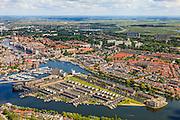 Nederland, Noord-Holland, Zaandam, 14-06-2012; Overzicht Zaandam met Zaaneiland in de voorgrond. Het eiland is gelegen in de monding van rivier de Zaan, tussen Voorzaan en de Oude Haven. Vroeger ingebruik bij de houtindustrie, o.a. houtwerven. Nieuwe woonwijk op eiland, waterstad. .Overview on Zaandam with new residential area on former industrial area on island on the river Zaan..luchtfoto (toeslag), aerial photo (additional fee required).foto/photo Siebe Swart