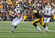 November 12, 2011: Michigan State Spartans running back Le'Veon Bell (24) tries to avoid Iowa Hawkeyes defensive lineman Broderick Binns (91) during the first half of the NCAA football game between the Michigan State Spartans and the Iowa Hawkeyes at Kinnick Stadium in Iowa City, Iowa on Saturday, November 12, 2011. Michigan State defeated Iowa 37-21.