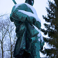 The WW I solider from Lens stands guard, even in winter.