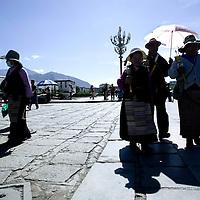 LHASA, JUNE-16, 2009 : pilgrims walk along the Potala Palace.