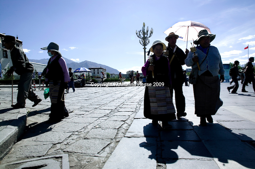 LHASA, JUNE-16, 2009 : pilgrims walk along the Potala Palace.