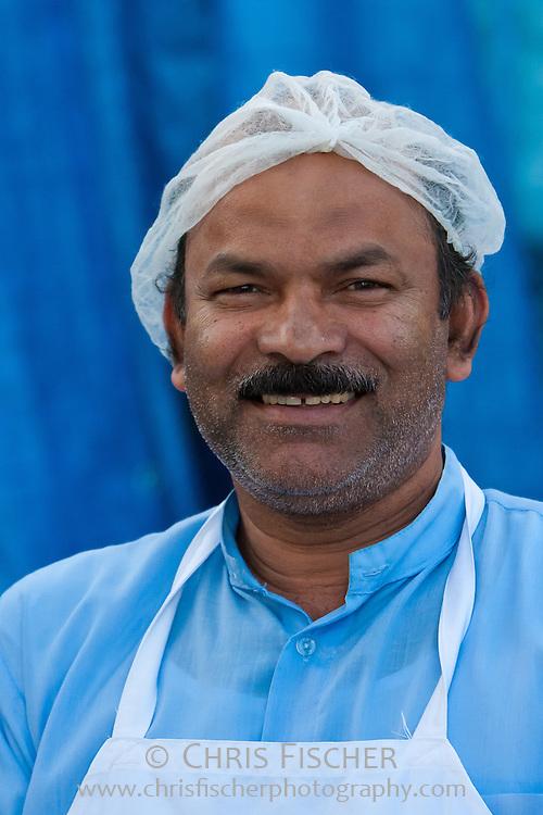 Man working at the Fish Market in Fujairah, UAE.