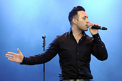 © Licensed to London News Pictures. 16/07/2015<br /> Rochester Castle Concerts,Rochester,Kent<br /> blue singing.<br /> Antony Costa<br /> (Byline:Grant Falvey/LNP)