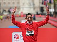 El Amin Chentouf MAR celebrates on the podium after winning the T12 Men World Para Athletics Marathon Championships. The Virgin Money London Marathon, 28 April 2019.<br /> <br /> Photo: Joe Toth for Virgin Money London Marathon<br /> <br /> For further information: media@londonmarathonevents.co.uk