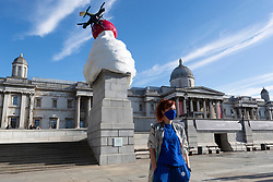 © Licensed to London News Pictures. 30/07/2020. London, UK. Artist Heather Phillipson poses with her Forth Plinth sculpture titled 'The End. The sculpture in Trafalgar Square consists of a fly and drone stuck on top of a giant ice cream cone. Photo credit: Ray Tang/LNP
