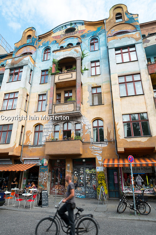 Colourful art painted on apartment buildings in bohemian Kreuzberg district of Berlin Germany