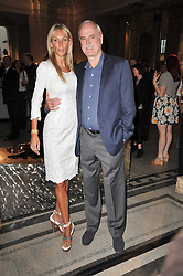 JOHN CLEESE and JENNIFER WADE at a private view of a new collection of bronzes and original paintings by artist Jonathan Wylder and his muse Jennifer Wade held at the V&A Museum, London on 27th April 2011.