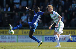 Oldham Athletic's Dominic Poleon is tackled by Yeovil Town's Byron Webster  - Photo mandatory by-line: Harry Trump/JMP - Mobile: 07966 386802 - 07/03/15 - SPORT - Football - Sky Bet League One - Yeovil Town v Oldham Athletic - Huish Park, Yeovil, England.