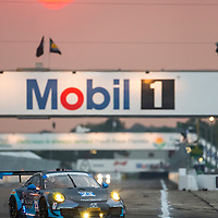 Sebring, FL - Mar 19, 2015:  The Team Seattle Alex Job Racing Porsche races through the turns at 12 Hours of Sebring at Sebring Raceway in Sebring, FL.