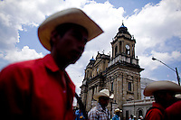 Citizens take to the streets as a day of protest in connection with Guatemala's President Alvaro Colom fill the Central Plaza in Guatemala City May 17, 2009. . Thousands of protesters took to the streets of the capital  Sunday in two separated rival marches, one in support of the President and one denouncing President Alvaro Colom who was accused this week of murder, money laundering and having ties with narco-traffickers.(Darren Hauck)