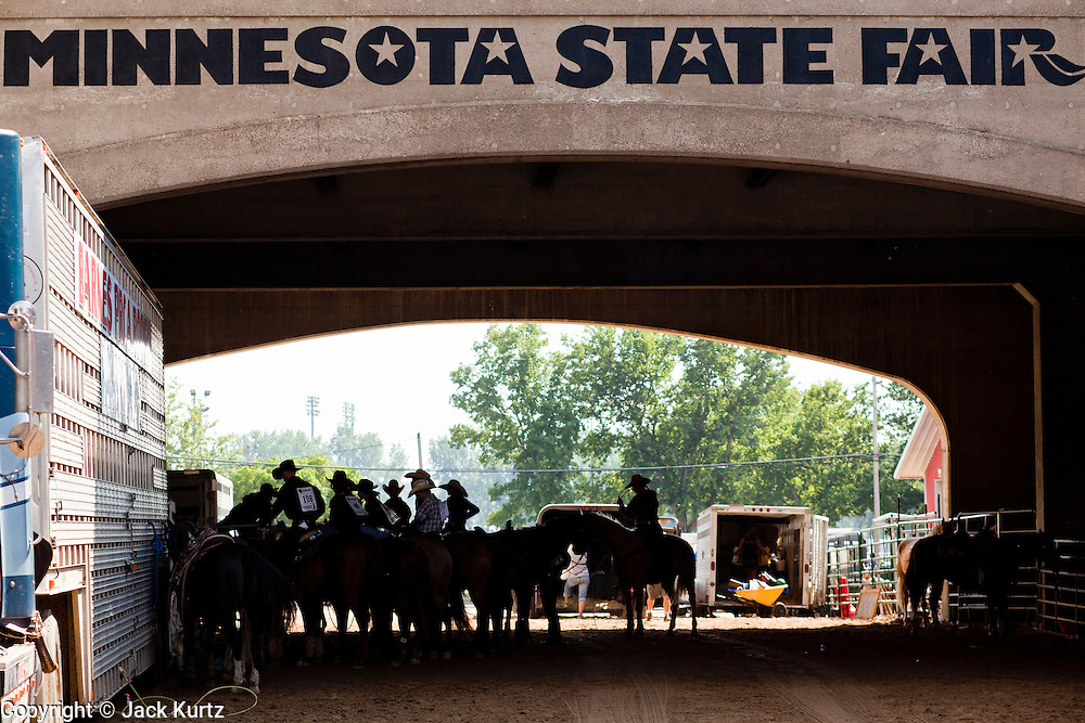 """01 SEPTEMBER 2011 - ST. PAUL, MN:  High school rodeo participants wait to enter the arena at the Minnesota State Fair. The Minnesota State Fair is one of the largest state fairs in the United States. It's called """"the Great Minnesota Get Together"""" and includes numerous agricultural exhibits, a vast midway with rides and games, horse shows and rodeos. Nearly two million people a year visit the fair, which is located in St. Paul.     PHOTO BY JACK KURTZ"""