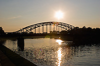 sun seen setting behind pilsudski bridge which crosses from krakow's kazimierz district to podgorze on september 2005