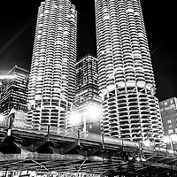 Marina City Towers at night black and white picture with State Street Bridge. Marina City is a residential complex of two round buildings located along the Chicago River.