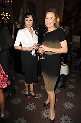 Left to right, MARIE HELVIN and JERRY HALL at a dinner hosted by Vogue in honour of photographer David Bailey at Claridge's, Brook Street, London on 11th May 2010.