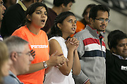 Fans watch the replay board during a game against Union College at the Gene Polisseni Center on October 3, 2014.
