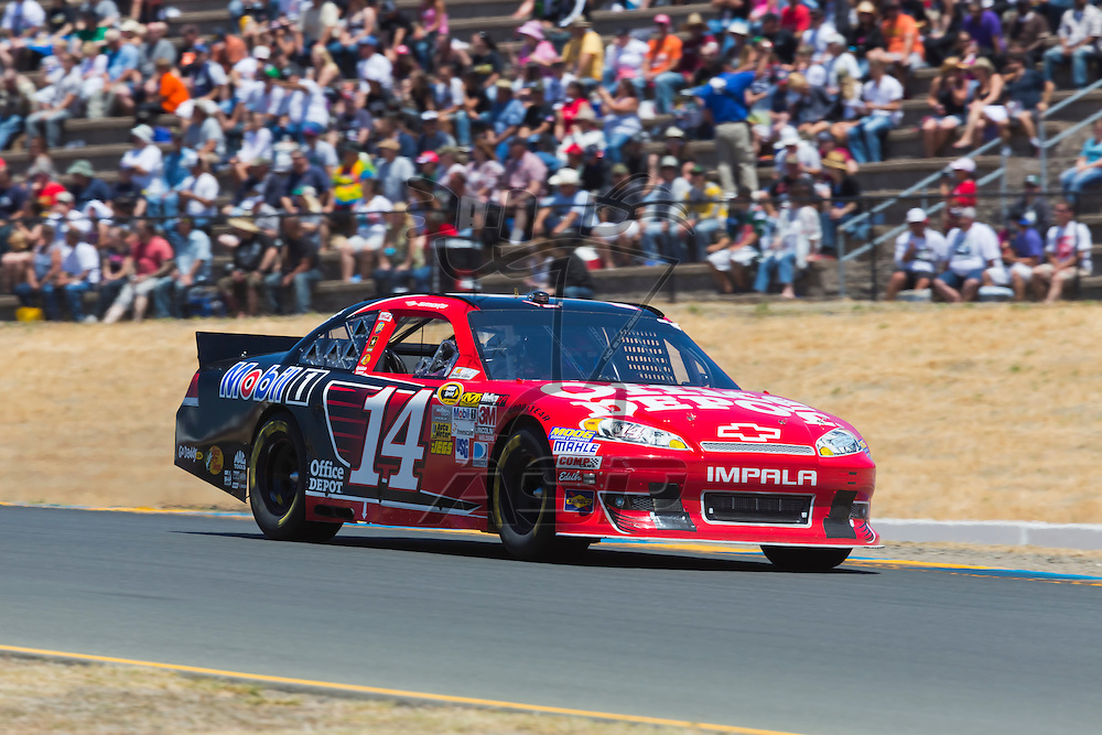 SONOMA, CA - JUN 24, 2012:  Tony Stewart (14) brings his car through the turns during the Toyota Save Mart 350 at the Raceway at Sonoma in Sonoma, CA.