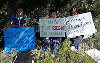 Protestors at Bear Creek High School in Lakewood, Colorado  sit in the shade near the school September 25, 2014 as high school students in Colorado's second-largest school district staged a walkout again Thursday to protest proposed changes to a history curriculum that would stress patriotism and discourage civil disobedience. REUTERS/Rick Wilking (UNITED STATES)