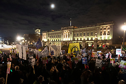 © Licensed to London News Pictures. 03/12/2019. London, UK. Anti Trump protesters outside Buckingham Palace to demonstrate against President Donald Trumps visit to the United Kingdom. Photo credit: George Cracknell Wright/LNP
